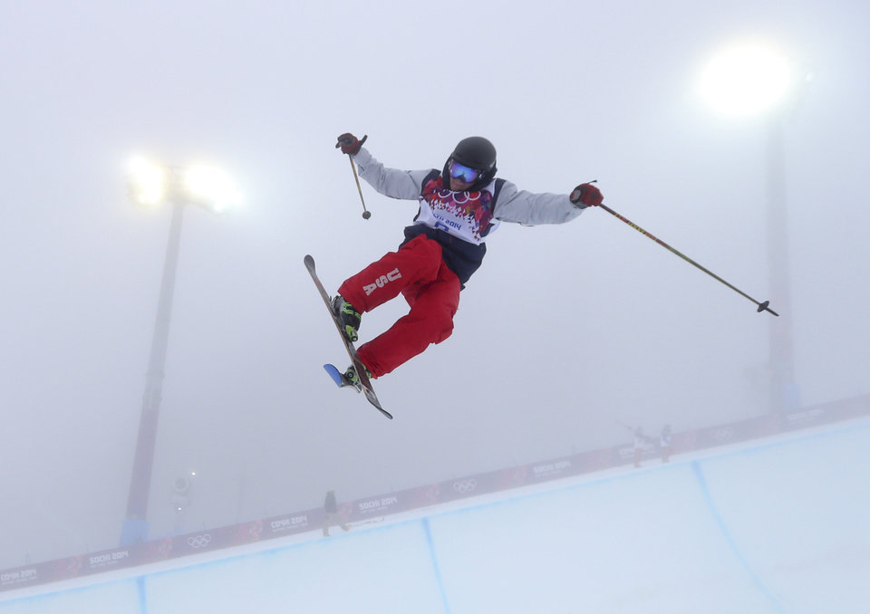 Photo - David Wise of the United States  jumps during a freestyle skiing training session in the halfpipe at the Rosa Khutor Extreme Park, at the 2014 Winter Olympics, Monday, Feb. 17, 2014, in Krasnaya Polyana, Russia. (AP Photo/Sergei Grits)