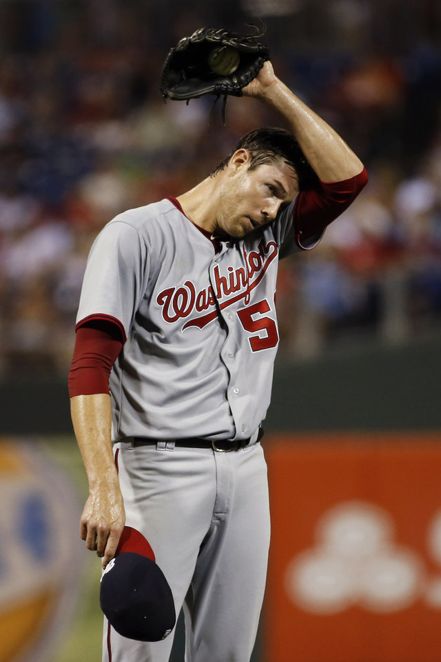 Photo - Washington Nationals starting pitcher Doug Fister wipes his face after hitting Philadelphia Phillies' Ben Revere with a pitch during the sixth inning of a baseball game, Wednesday, Aug. 27, 2014, in Philadelphia. Philadelphia won 8-4. (AP Photo/Matt Slocum)