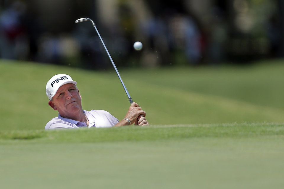 Photo - Mark Calcavecchia hits onto the 9th hold green the U.S. Senior Open golf tournament at Oak Tree National in Edmond, Okla., Thursday, July 10, 2014. Photo by Sarah Phipps, The Oklahoman