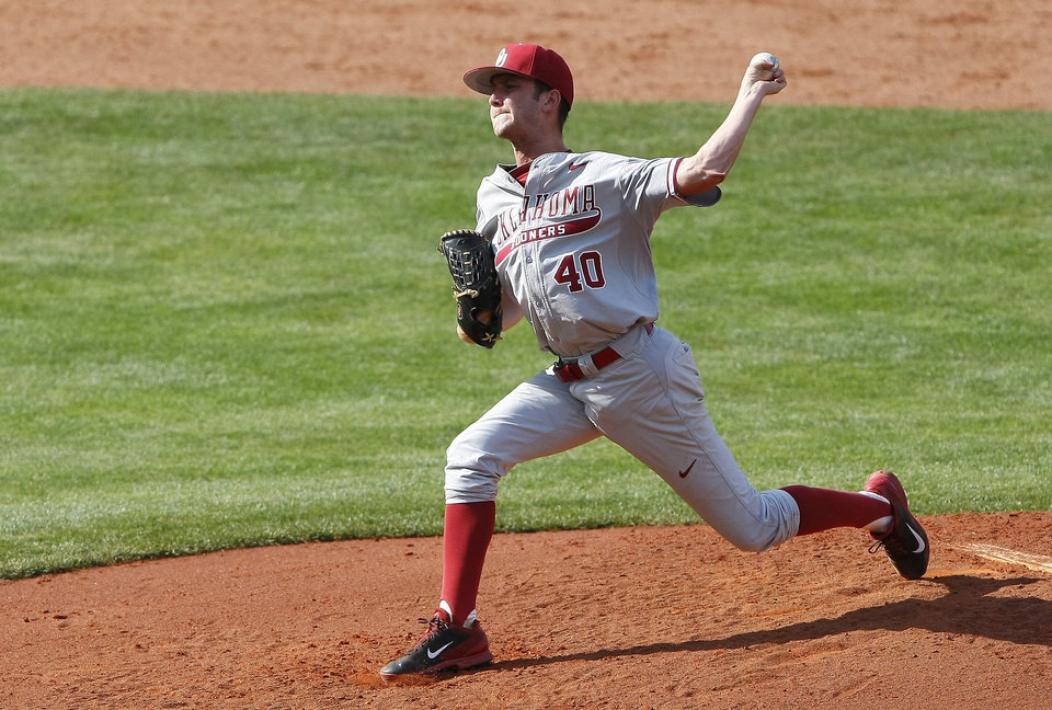 Photo - Oklahoma's Jeffrey Curran pitches in the first inning of a first-round game against Oklahoma State in the Big 12 conference NCAA college baseball tournament in Oklahoma City, Wednesday, May 21, 2014. (AP Photo/Alonzo Adams)