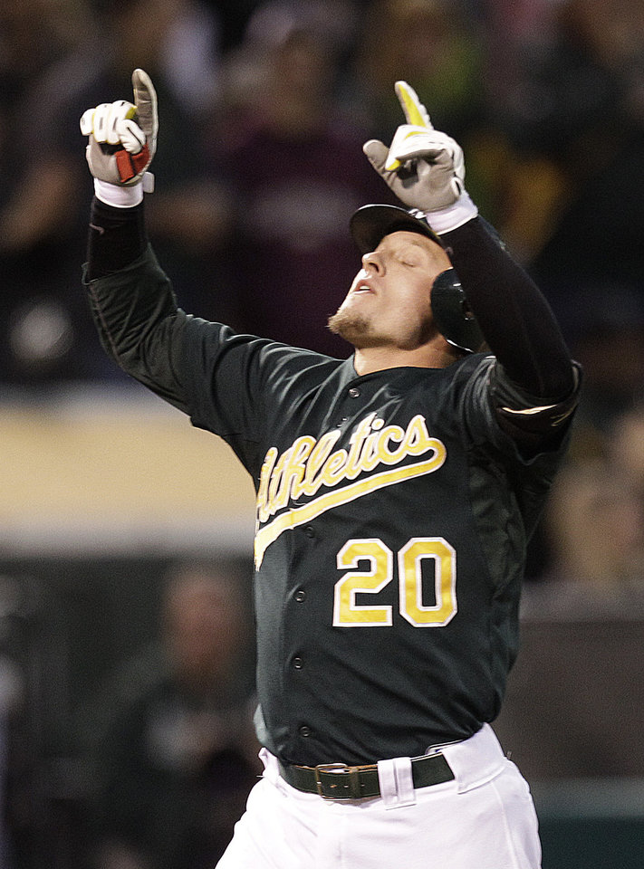 Photo -   Oakland Athletics' Josh Donaldson celebrates after hitting a two-run home run off Boston Red Sox's Aaron Cook in the second inning of a baseball game Friday, Aug. 31, 2012, in Oakland, Calif. (AP Photo/Ben Margot)