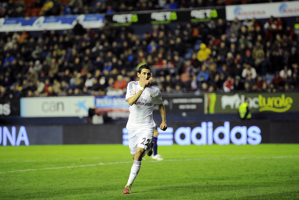 Photo - Real Madrid's Angel Di Maria of Argentina, celebrates his goal during their Spanish Copa del Rey round-16 second leg soccer match between Osasuna and Real Madrid , at El Sadar stadium, in Pamplona northern Spain on Wednesday, Jan. 15, 2014. (AP Photo/Alvaro Barrientos)