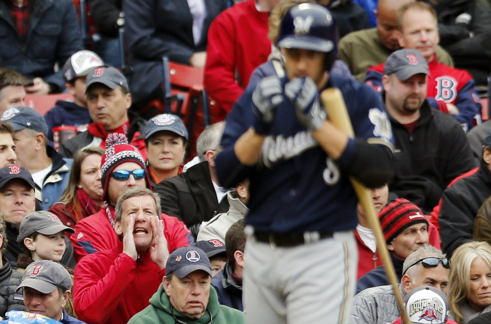 Photo - A fan jeers as Milwaukee Brewers' Ryan Braun comes up to bat in the seventh inning of a baseball game against the Boston Red Sox in Boston, Friday, April 4, 2014. (AP Photo/Michael Dwyer)