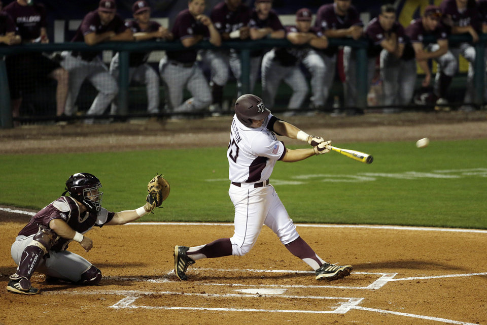 Photo - Texas A&M's Hunter Melton hits an RBI-single in the first inning of their Southeastern Conference Tournament NCAA college baseball game against Mississippi State at the Hoover Met in Hoover, Ala., Thursday, May 23, 2013. (AP Photo/Dave Martin)
