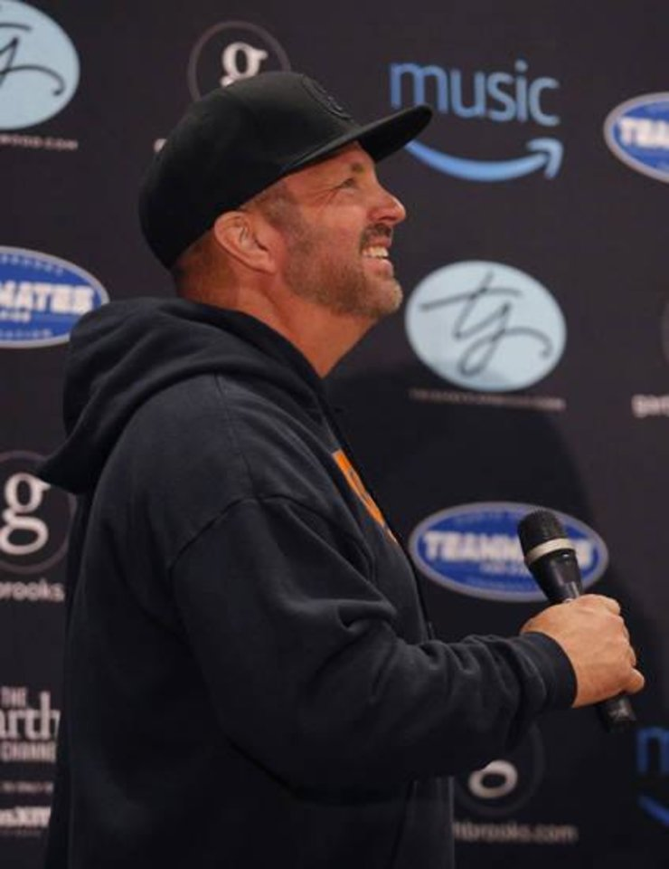 Photo - Garth Brooks talks to reporters during a news conference Friday at Chesapeake Energy Arena in Oklahoma City. Photo by Sarah Phipps, The Oklahoman