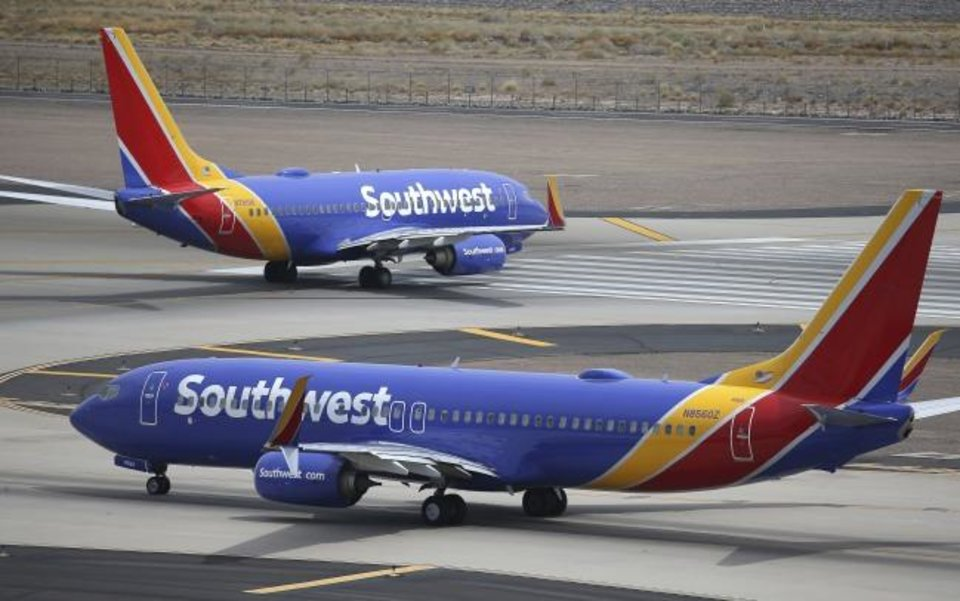 Photo -  Southwest Airlines planes are shown at Phoenix Sky Harbor International Airport in Phoenix. [AP PHOTO]