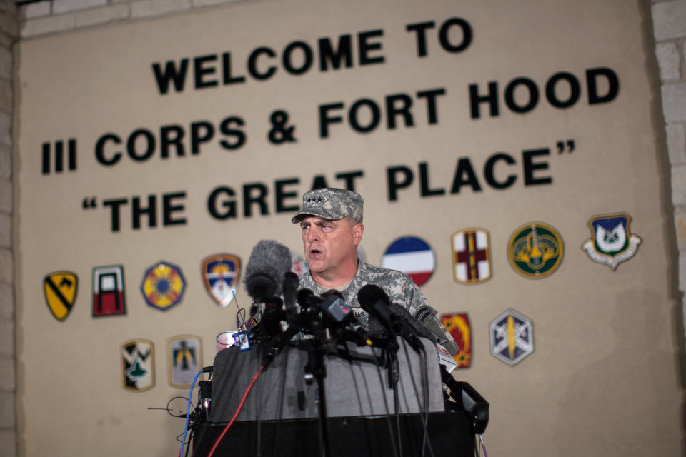 Photo - Lt. Gen. Mark Milley, commanding general of III Corps and Fort Hood, speaks with the media outside of an entrance to the Fort Hood military base following a shooting that occurred inside, Wednesday, April 2, 2014, in Fort Hood, Texas. Four people were killed, including the gunman, and 16 were wounded in the attack, authorities said. (AP Photo/Tamir Kalifa)