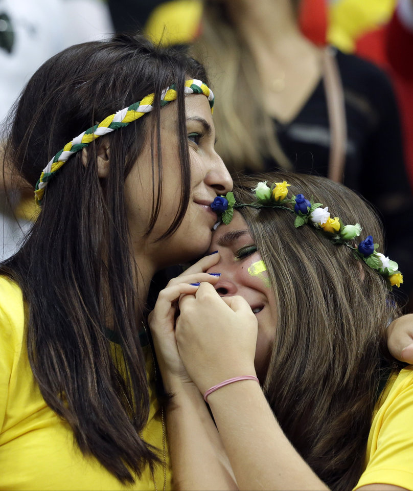 Photo - Brazil supporters react after the World Cup third-place soccer match between Brazil and the Netherlands at the Estadio Nacional in Brasilia, Brazil, Saturday, July 12, 2014. The Netherlands won the match 3-0. (AP Photo/Hassan Ammar)