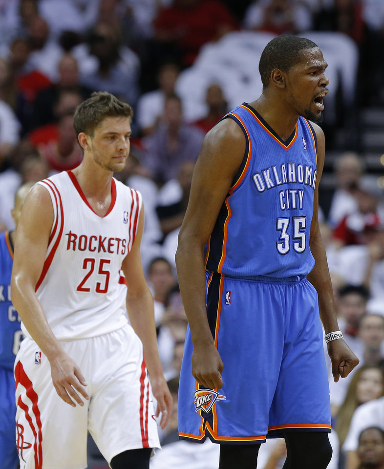 Oklahoma City\'s Kevin Durant (35) reacts next to Houston\'s Chandler Parsons (25) during Game 3 in the first round of the NBA playoffs between the Oklahoma City Thunder and the Houston Rockets at the Toyota Center in Houston, Texas, Saturday, April 27, 2013. Photo by Bryan Terry, The Oklahoman