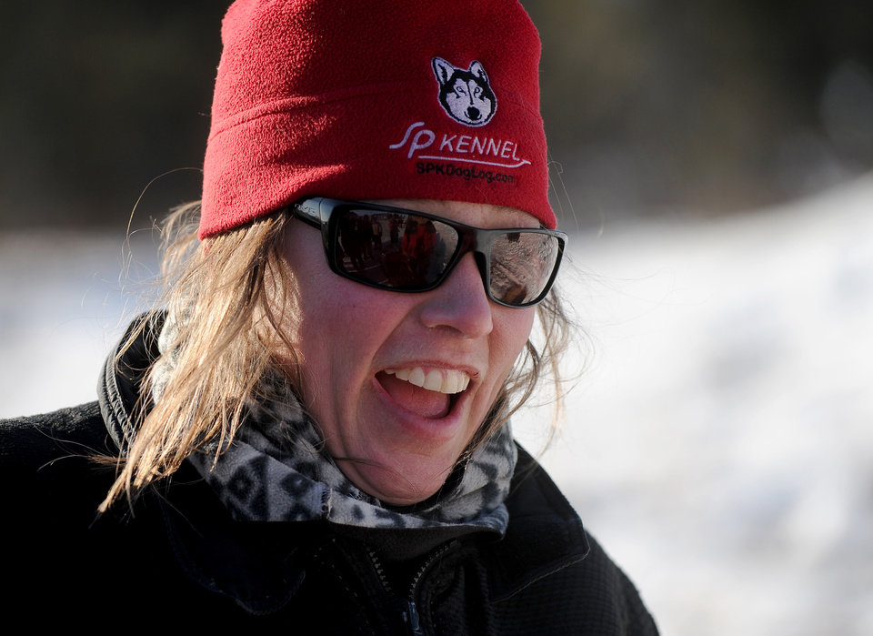 Photo - Iditarod musher Aliy Zirkle, from Two Rivers, Alaska, reacts to the problems with trail leaving the Koyuk checkpoint during the 2014 Iditarod Trail Sled Dog Race on Sunday, March 9, 2014 in Koyuk, Alaska. (AP Photo/The Anchorage Daily News, Bob Hallinen)