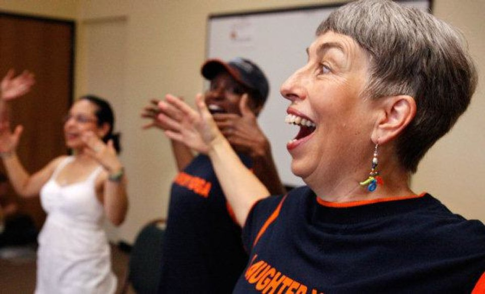 Photo - Instructor Ellen Mercer, right, leads participants in a laughing yoga class.    Photo by Jim Beckel, The Oklahoman  JIM BECKEL
