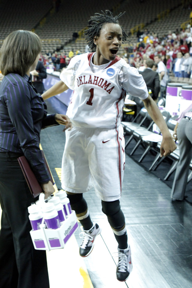 Photo - Nyeshia Stevenson celebrates as the University of Oklahoma (OU) defeats Georgia Tech 69-50 in round two of the 2009 NCAA Division I Women's Basketball Tournament at Carver-Hawkeye Arena at the University of Iowa in Iowa City, IA on Tuesday, March 24, 2009. 