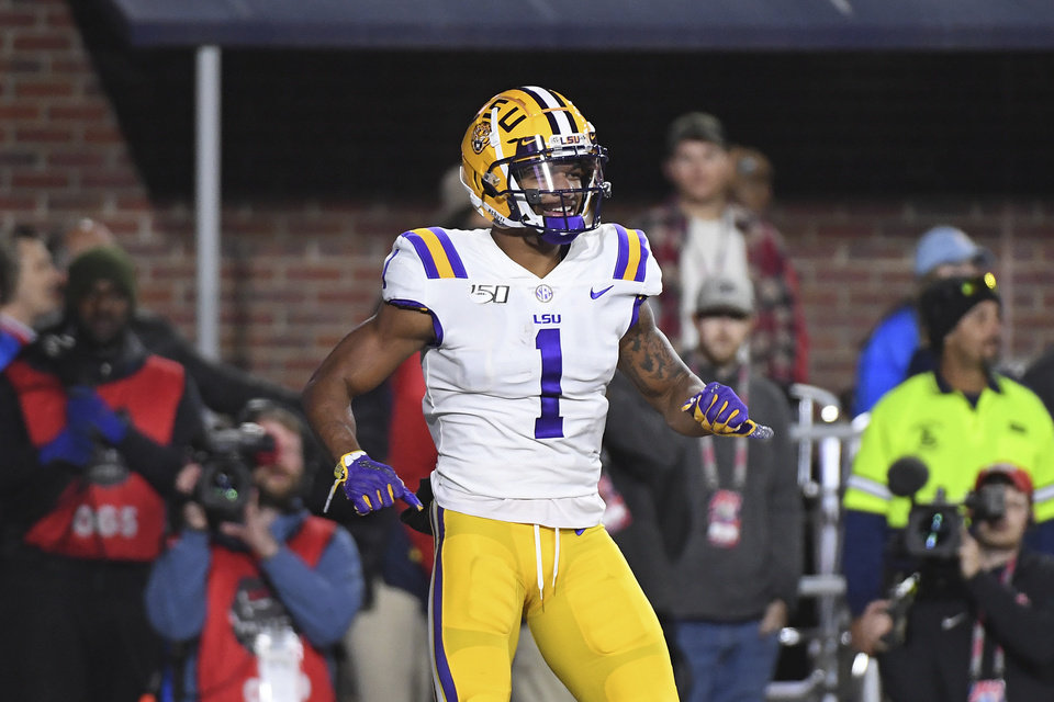 Photo - LSU wide receiver Ja'Marr Chase (1) reacts after a 34-yard touchdown catch during the first half of an NCAA college football game against Mississippi in Oxford, Miss., Saturday, Nov. 16, 2019. (AP Photo/Thomas Graning)