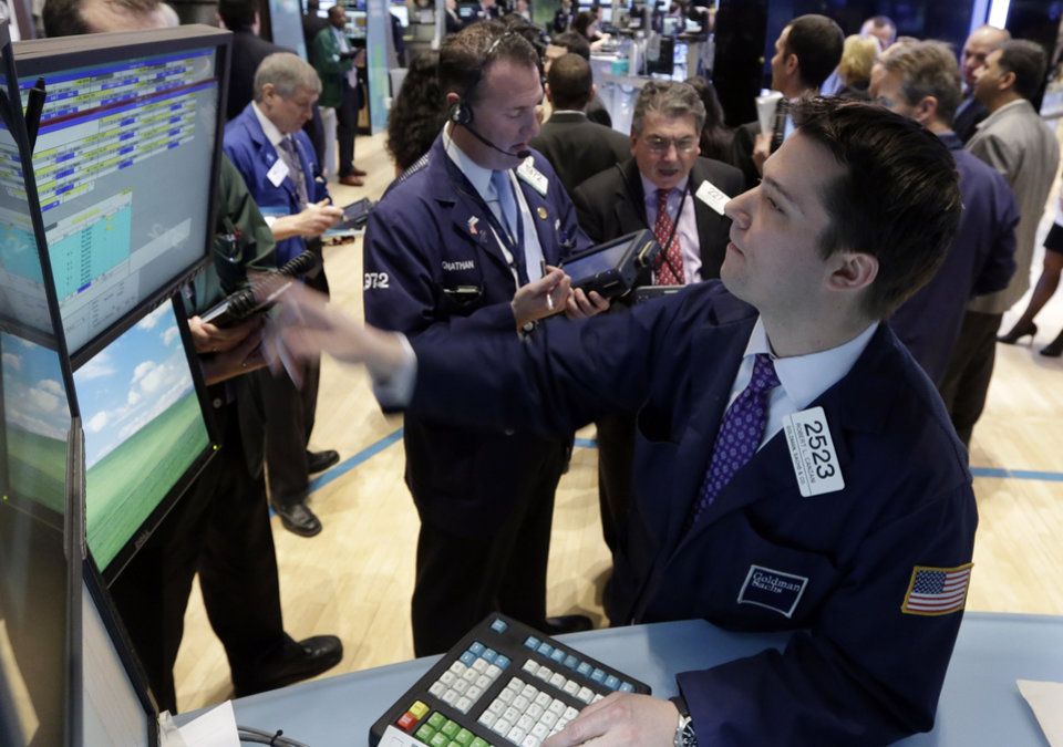 Specialist Robert Canzani, right, works at his post on the floor of the New York Stock Exchange Monday, Feb. 25, 2013. Stocks are opening higher on Wall Street, following the first weekly decline in the S&P 500 index this year. (AP Photo/Richard Drew)