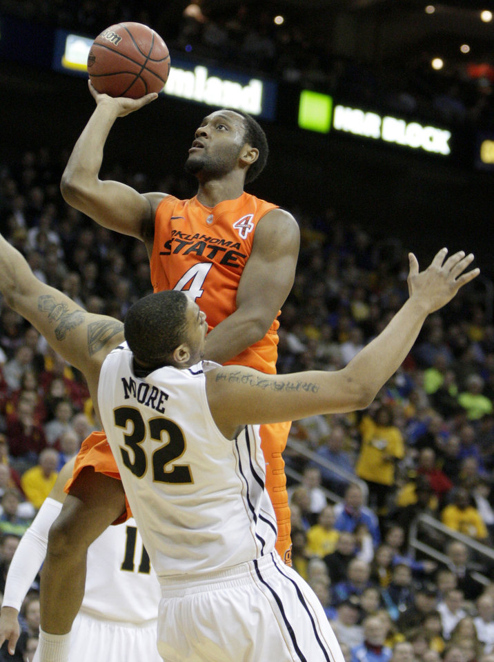Oklahoma's Brian Williams (4) shoots over Missouri's Steve Moore (32) during the Big 12 tournament men's basketball game between the Oklahoma State Cowboys and Missouri Tigers the Sprint Center, Thursday, March 8, 2012 Photo by Sarah Phipps, The Oklahoman