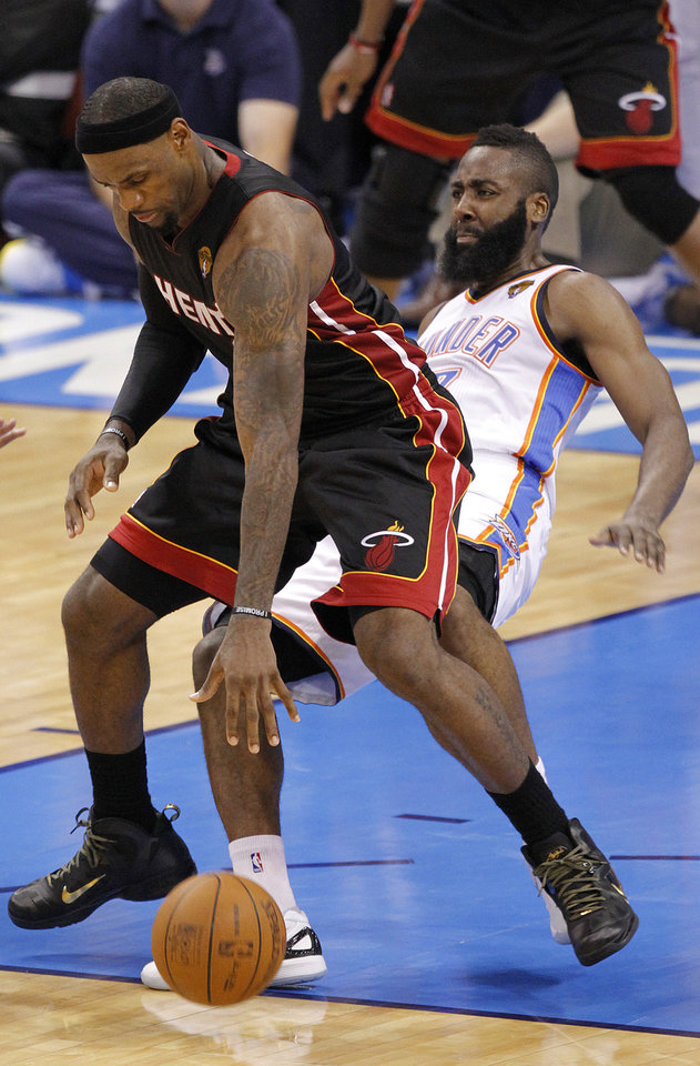 Photo - Oklahoma City's James Harden (13) tries to defend on Miami's LeBron James (6) during Game 2 of the NBA Finals between the Oklahoma City Thunder and the Miami Heat at Chesapeake Energy Arena in Oklahoma City, Thursday, June 14, 2012. Photo by Chris Landsberger, The Oklahoman
