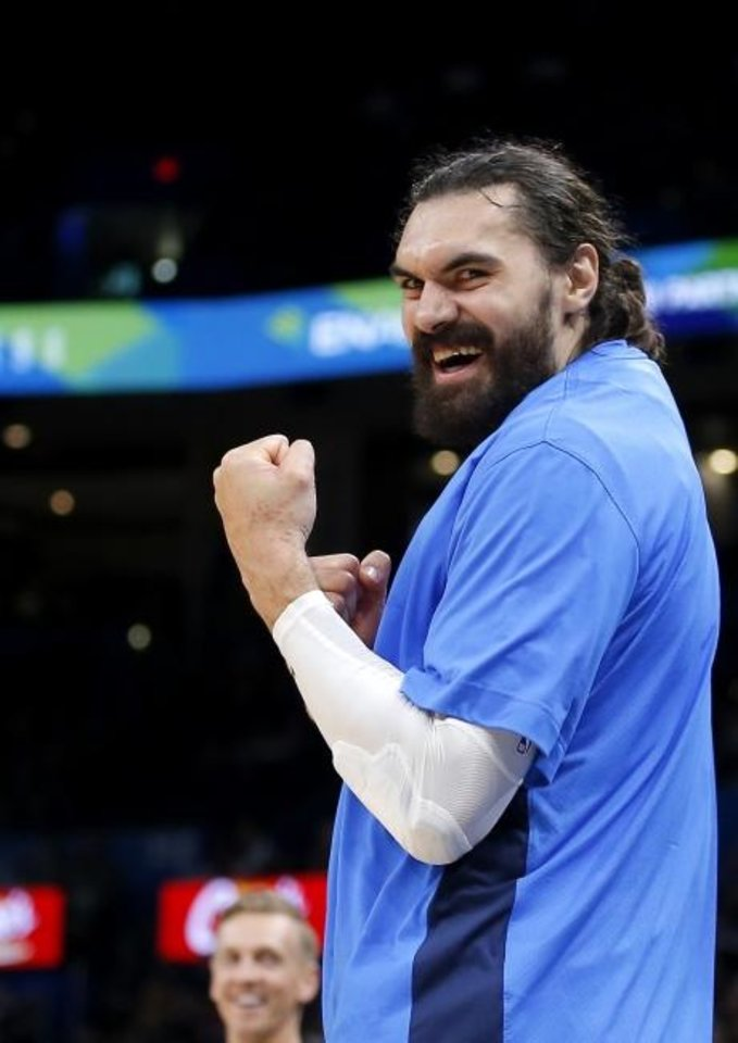 Photo -  Oklahoma City's Steven Adams cheers from the bench during game earlier this season.  [Sarah Phipps/The Oklahoman]