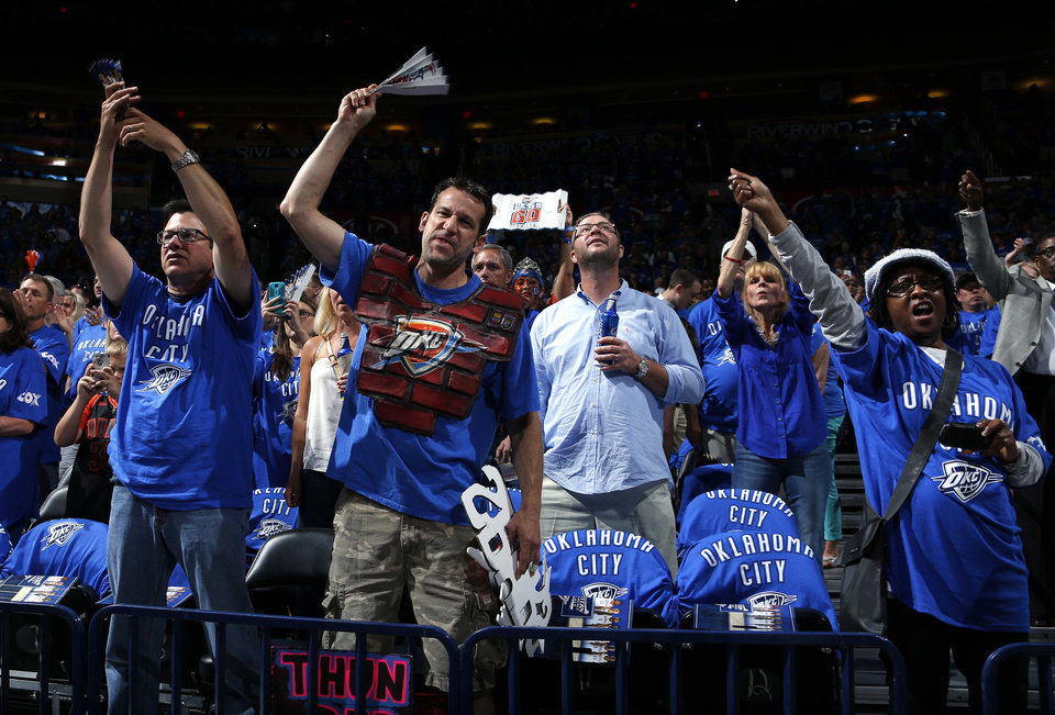 Photo - Fans celebrate before Game 3 of the Western Conference Finals in the NBA playoffs between the Oklahoma City Thunder and the San Antonio Spurs at Chesapeake Energy Arena in Oklahoma City, Sunday, May 25, 2014. Photo by Bryan Terry, The Oklahoman