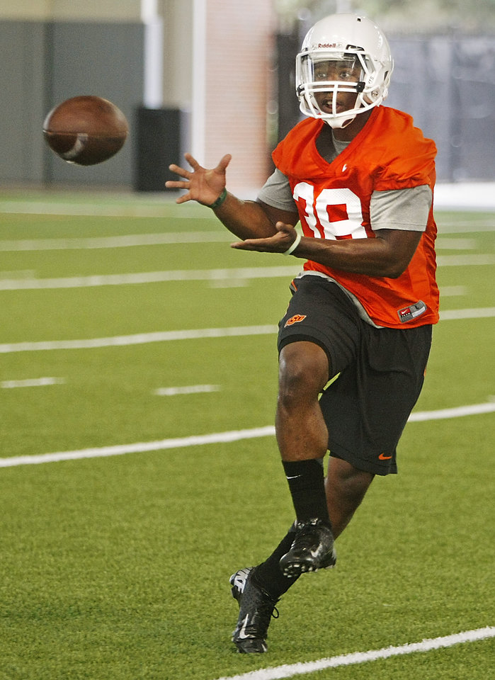 Photo - Oklahoma State wide receiver Kameron Doolittle (38) catches a ball during the first team practice of the fall at the Sherman E. Smith Training Facility on the campus of Oklahoma State University in Stillwater on August 1, 2014. Photo by KT King, The Oklahoman