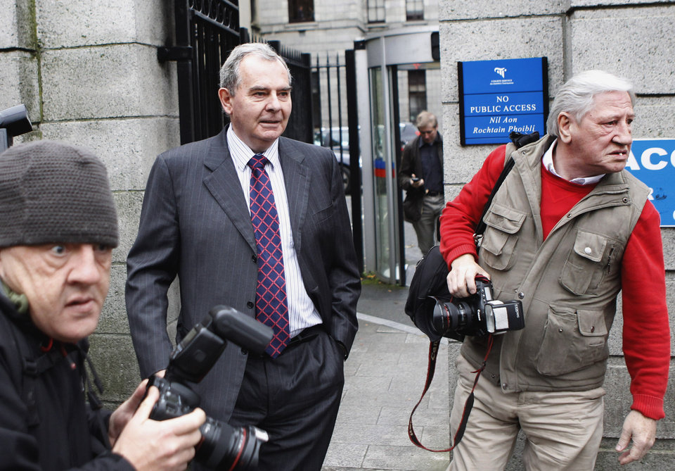 Photo -   FILE This Friday, Oct. 19, 2012 file photo shows Sean Quinn leaving Dublin high court, Dublin, Ireland. A judge in Ireland on Friday Nov. 2, 2012 ordered bankrupt tycoon Sean Quinn jailed for nine weeks for failing to observe orders to stop placing foreign property assets beyond the reach of creditors. Quinn — Ireland's richest man until 2008 — faces financial ruin because of his reckless gamble that year on Anglo Irish Bank. The Dublin lender was the biggest financier of Ireland's runaway property market, a boom that imploded in 2009.(AP Photo/Peter Morrison, File )