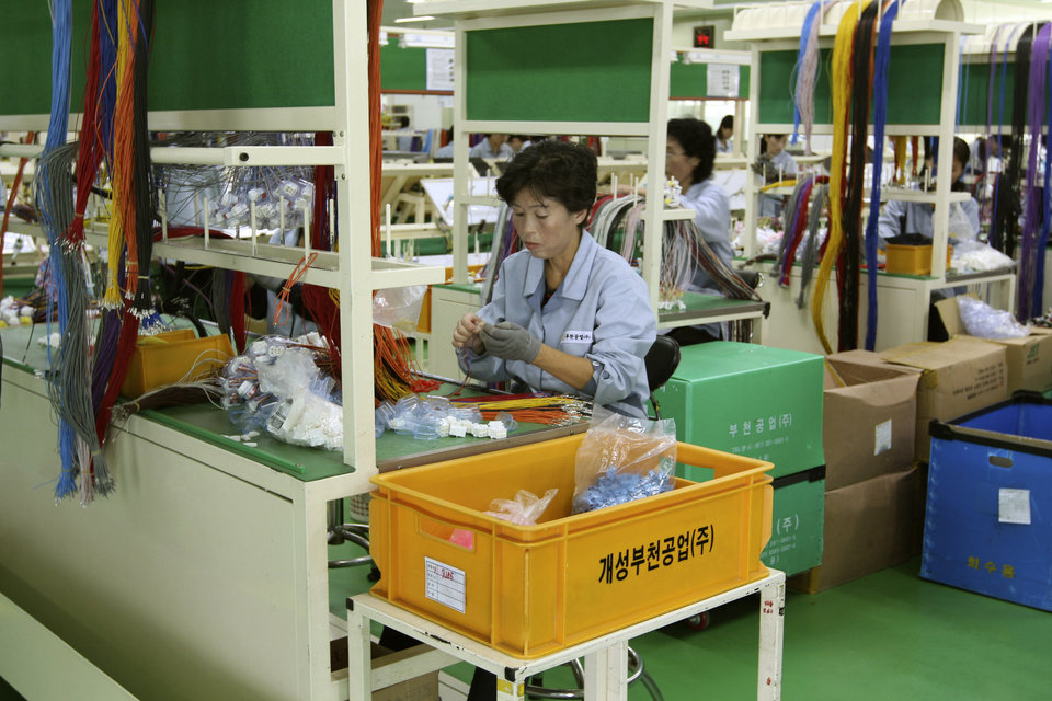 In this Sept. 21, 2012 photo, a North Korean worker handles wires at a South Korean-run factory inside the Kaesong industrial complex in Kaesong, North Korea. On Wednesday, April 3, 2013, North Korea refused entry to South Koreans trying to cross the Demilitarized Zone to get to their jobs managing factories in the North Korean city of Kaesong. Pyongyang had threatened in recent days to close the border in anger over South Korea's support of U.N. sanctions punishing North Korea for conducting a nuclear test in February. (AP Photo/Jean H. Lee)