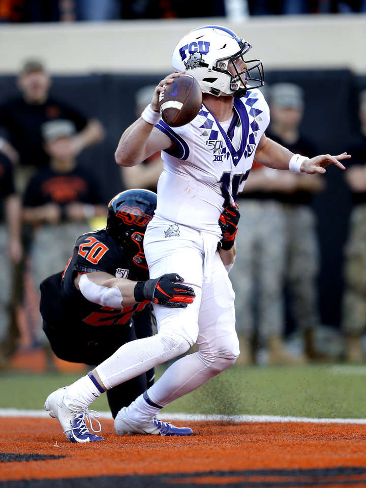 Photo - Oklahoma State's Malcolm Rodriguez (20) pressures TCU's Max Duggan (15) in the third quarter during the college football game between the Oklahoma State University Cowboys and the TCU Horned Frogs at Boone Pickens Stadium in Stillwater, Okla.,  Saturday, Nov. 2, 2019. OSU won 34-27. [Sarah Phipps/The Oklahoman]