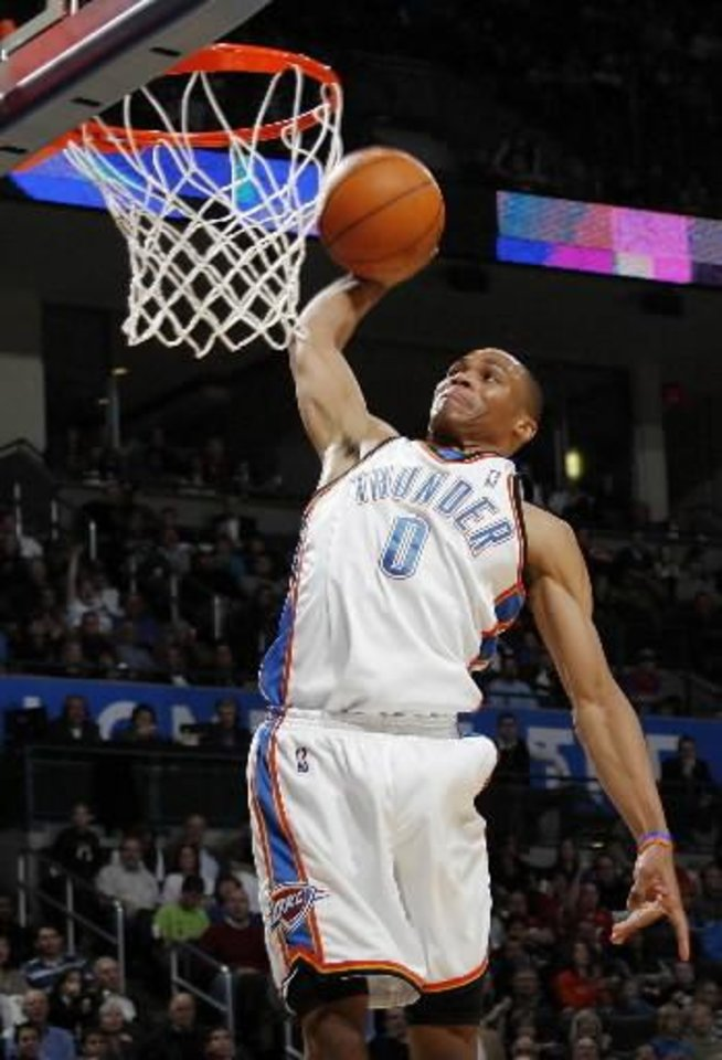 Photo - Oklahoma City's  Russell  Westbrook (0) dunks the ball during the NBA basketball game between the Atlanta Hawks and the Oklahoma City Thunder at the Ford Center in Oklahoma City, Tuesday, February 2, 2010. The Thunder won, 106-99. Photo by Nate Billings, The Oklahoman