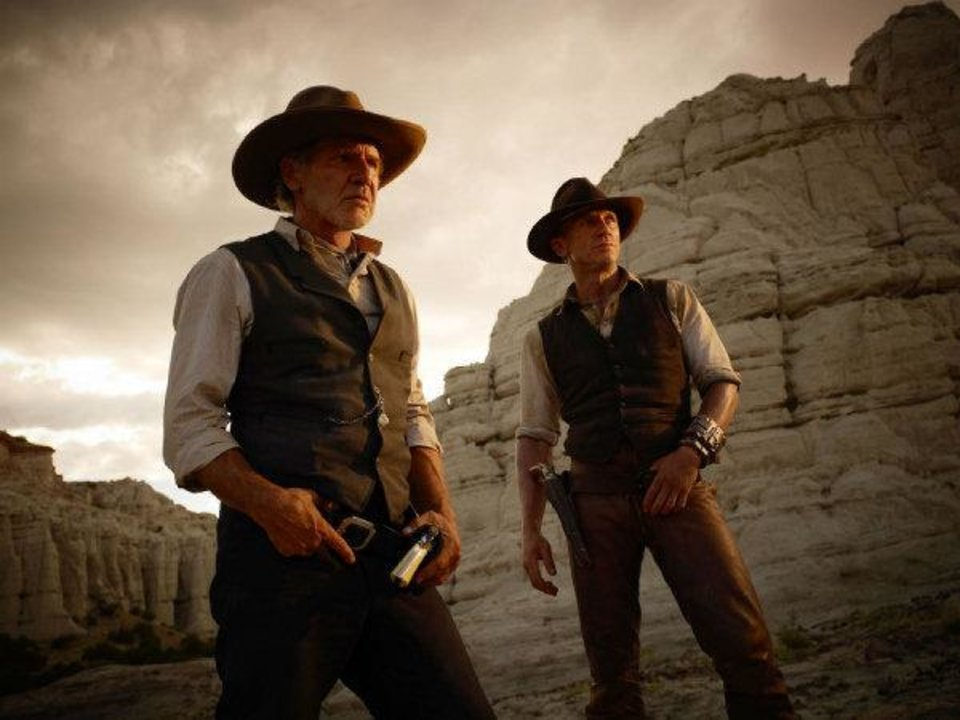 "From left, Harrison Ford and Daniel Craig appear in a scene from ""Cowboys and Aliens."" Universal Pictures photo <strong>Timothy White</strong>"