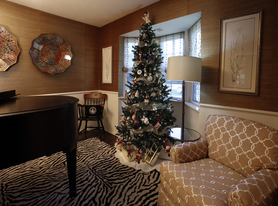 A parlor grand piano and Christmas tree are seen in Eilizabeth Greenhey's home on Tuesday, Nov. 6, 2012 in Norman, Okla.  Photo by Steve Sisney, The Oklahoman