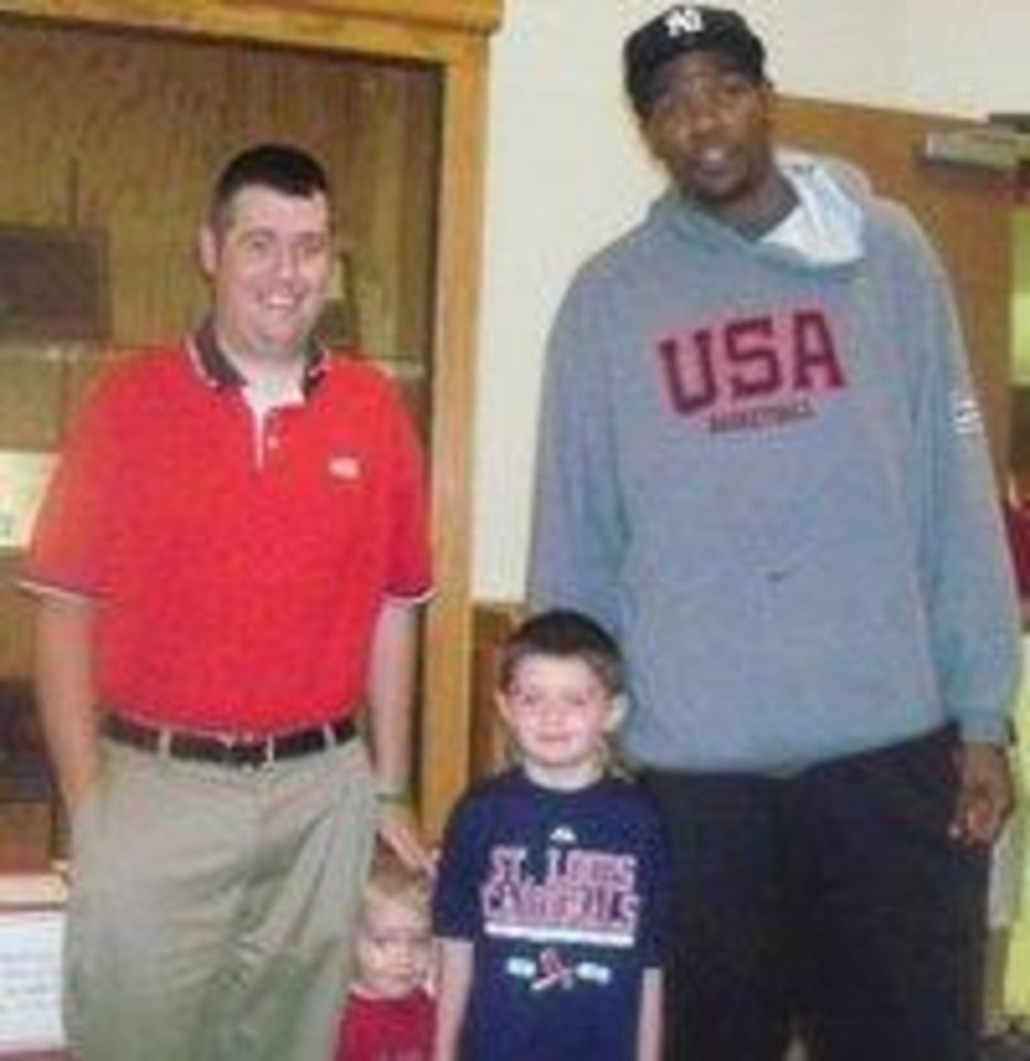 Photo -  The Convirs family with Kevin Durant. PHOTO PROVIDED