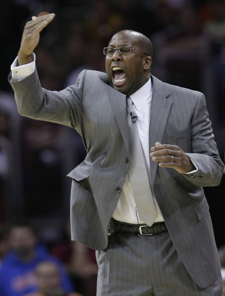 Photo - FILE - In this April 17, 2010 file photo, Cleveland Cavaliers coach Mike Brown yells at his team in the third quarter of Game 1 against the Chicago Bulls in the first round of the NBA basketball playoffs in Cleveland. Cleveland officially re-hired Mike Brown on Wednesday, April 24, 2013, bringing back a coach who guided them to five straight playoff appearances and their only trip to the NBA Finals before he was fired following the 2010 season. (AP Photo/Tony Dejak, File)