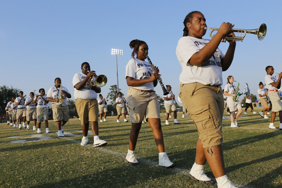 Photo - The Star Spencer band performs during the pregame at the high school football game between Millwood and Star Spencer in Spencer, Thursday, September 5, 2013. Photo by Doug Hoke, The Oklahoman