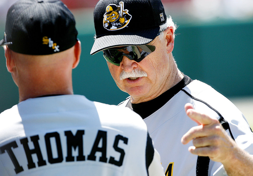 Wichita State University head coach Gene Stephenson (right) talks with assistant coach Jim Thomas between innings during their college baseball game against Houston at the 2006 NCAA Norman Regional at the University of Oklahoma\'s L. Dale Mitchell Park in Norman, Okla., Friday, June 2, 2006. Wichita State won the game 2-1. By John Clanton, The Oklahoman