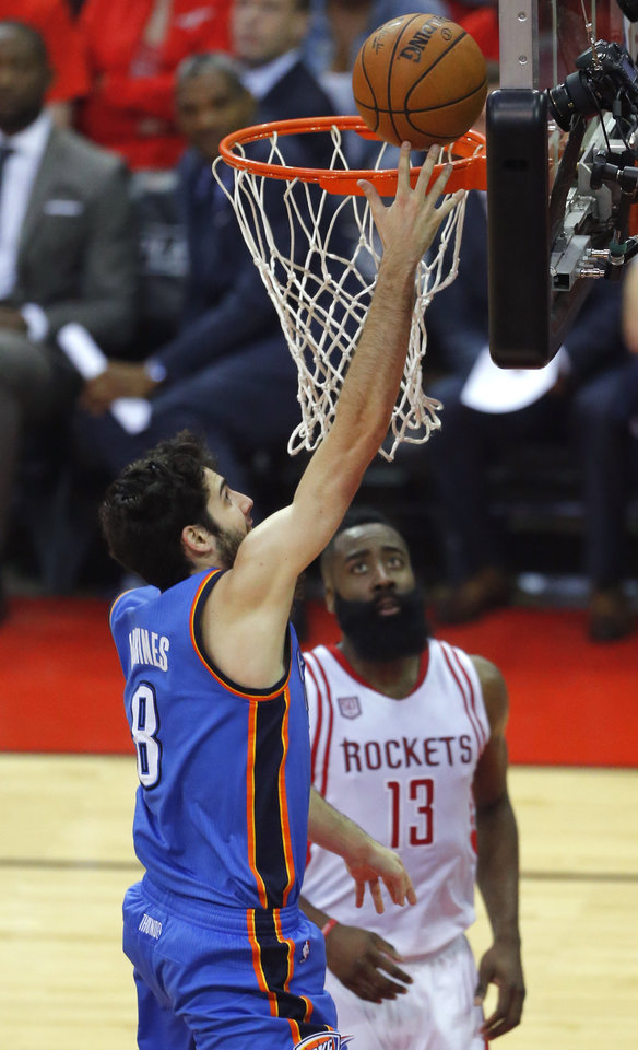Photo - Oklahoma City's Alex Abrines (8) goes to the basket as Houston's James Harden (13) watches during Game 5 in the first round of the NBA playoffs between the Oklahoma City Thunder and the Houston Rockets at the Toyota Center in Houston, Texas,  Tuesday, April 25, 2017.  Photo by Sarah Phipps, The Oklahoman