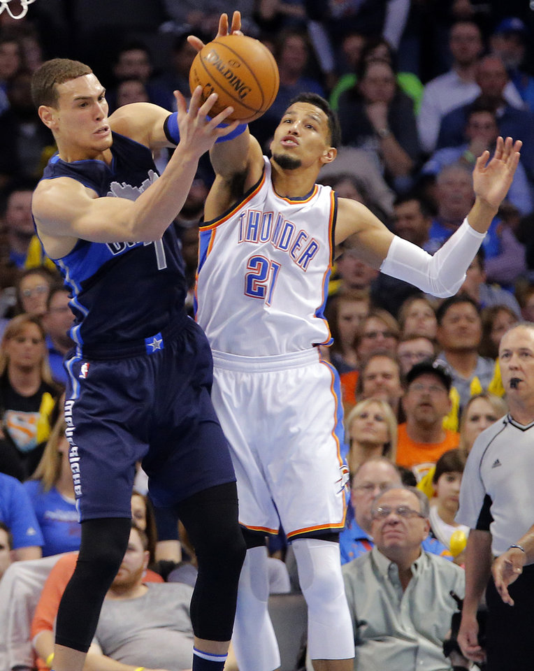 Photo - Dallas' Dwight Powell (7) and Oklahoma City's Andre Roberson (21) fight for a rebound during the NBA basketball game between the Oklahoma City Thunder and the Dallas Mavericks at Chesapeake Energy Arena on Wednesday, Jan. 13, 2016, in Oklahoma City, Okla.  Photo by Chris Landsberger, The Oklahoman