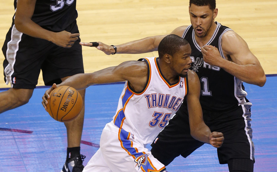 Photo - Oklahoma City's Kevin Durant (35) goes around San Antonio's Jeff Ayres (11) during Game 4 of the Western Conference Finals in the NBA playoffs between the Oklahoma City Thunder and the San Antonio Spurs at Chesapeake Energy Arena in Oklahoma City, Tuesday, May 27, 2014. Photo by Bryan Terry, The Oklahoman