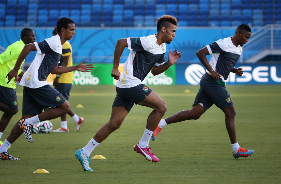 Photo - Cameroon soccer players warm up during a training session at the Arena das Dunas in Natal, Brazil, Thursday, June 12, 2014. Cameroon will play in group A in the Brazil 2014 soccer World Cup. (AP Photo/Sergei Grits)