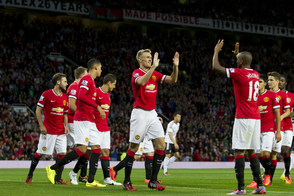 Photo - Manchester United's Darren Fletcher, centre, celebrates with teammates after scoring against Valencia, during a pre season friendly soccer match at Old Trafford Stadium, Manchester, England, Tuesday Aug. 12, 2014. (AP Photo/Jon Super)