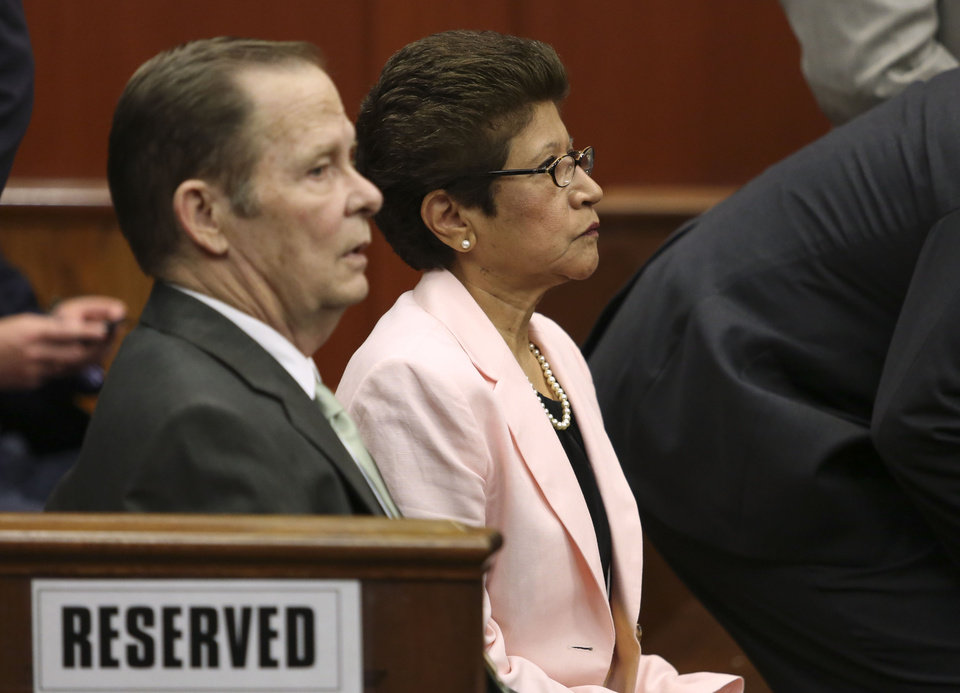 Photo - George Zimmerman's parents, Robert Zimmerman Sr., left, and Gladys Zimmerman sit in court for closing arguments in their son's trial in Seminole circuit court in Sanford, Fla. Thursday, July 11, 2013. Zimmerman has been charged with second-degree murder for the 2012 shooting death of Trayvon Martin. (AP Photo/Orlando Sentinel, Gary W. Green, Pool)
