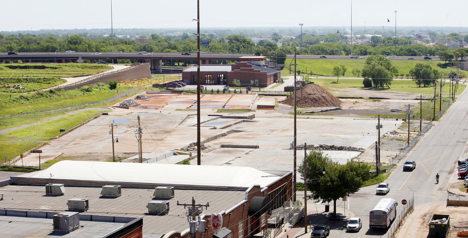 Photo - Slabs are all that remain of the former Stewart Metal Fabricators complex on the north side of Sheridan Avenue in Bricktown. Those slabs will be removed, and soil clean-up is set to begin next month as developers prepare to build housing, a hotel, retail and a garage.  PAUL B. SOUTHERLAND