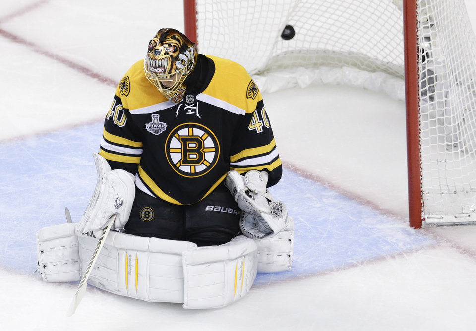 Photo - A goal by Chicago Blackhawks center Jonathan Toews hits the net behind Boston Bruins goalie Tuukka Rask (40), of Finland, during the second period in Game 6 of the NHL hockey Stanley Cup Finals, Monday, June 24, 2013, in Boston. (AP Photo/Charles Krupa)