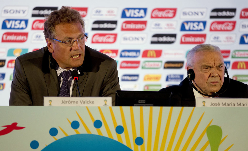 Photo - FIFA's Secretary General Jerome Valcke, left, and Brazil Football Confederation President Jose Maria Marin attend a press conference in Rio de Janeiro, Brazil, Thursday, Aug. 22, 2013. FIFA's secretary general has floated an idea for a possible change to the World Cup bidding process in response to a spate of challenges in organizing next year's tournament in Brazil, which he says has