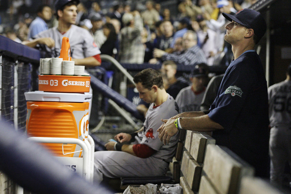 Boston Red Sox players react after their 14-2 loss to the New York Yankees in a baseball game, Wednesday, Oct. 3, 2012, in New York. (AP Photo/Frank Franklin II)