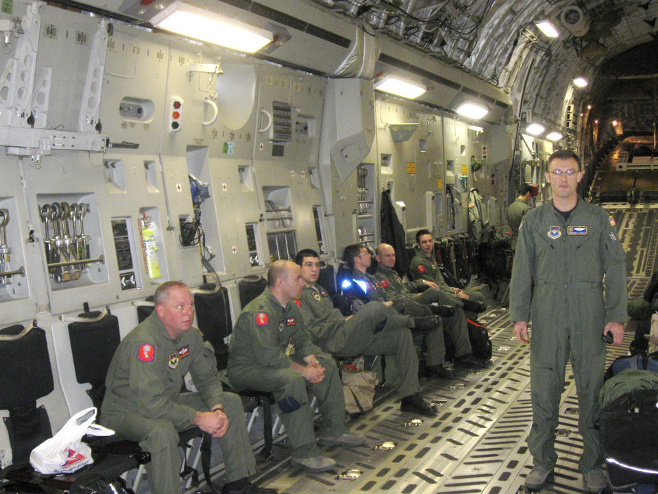 Photo - EARTHQUAKE RELIEF / ASSISTANCE / AID: Crew prepares for takeoff in a C-17 at Altus Air Force base to go to Haiti Monday, Jan. 18, 2010. Photo by Ron Jackson, The Oklahoman. ORG XMIT: KOD