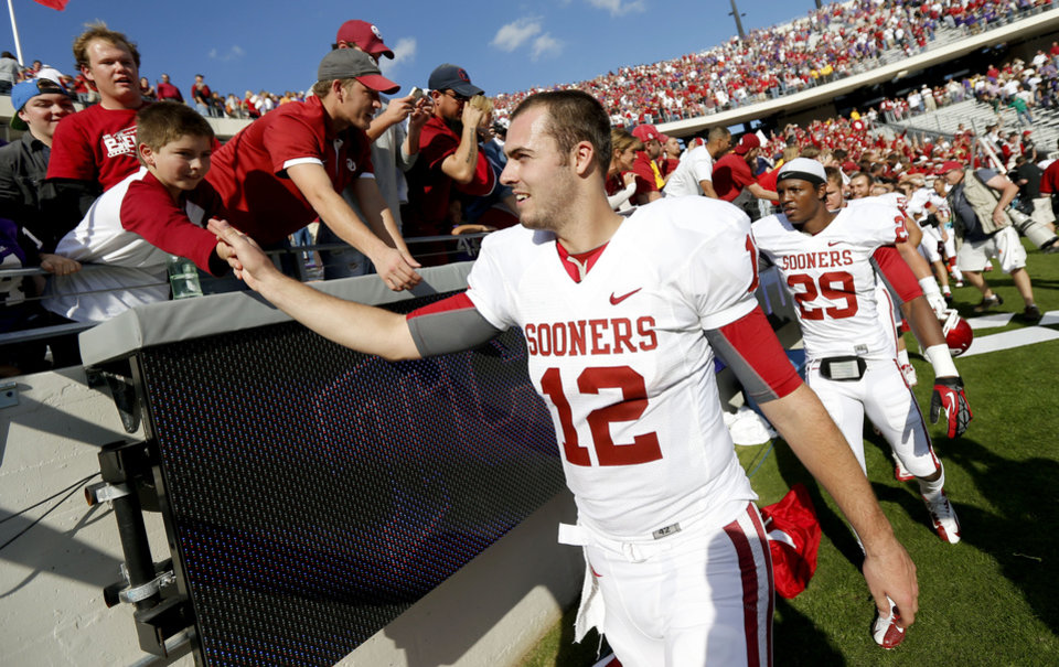 Photo - Oklahoma's Landry Jones (12) celebrates with fans after a college football game between the University of Oklahoma Sooners (OU) and the Texas Christian University Horned Frogs (TCU) at Amon G. Carter Stadium in Fort Worth, Texas, Saturday, Dec. 1, 2012. Oklahoma won 24-17. Photo by Bryan Terry, The Oklahoman