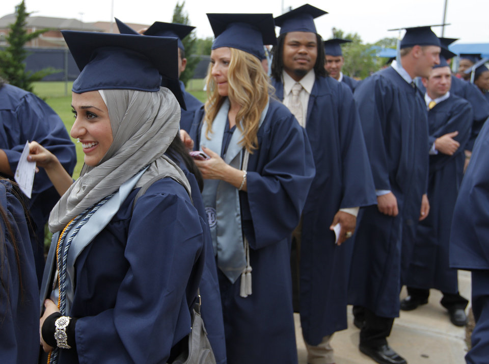 Sarah Amin, a psychology major, waits to walk during a University of Central Oklahoma graduation ceremony in Edmond, Friday, May 4. Photo by Garett Fisbeck, For The Oklahoman