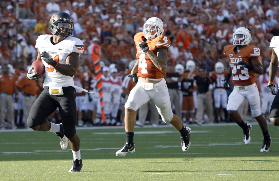 Photo - Oklahoma State's Jeremy Smith (31) runs in for a touchdown as Texas' Kenny Vaccaro (4) and Carrington Byndom (23) chase him down during second half of a college football game between the Oklahoma State University Cowboys (OSU) and the University of Texas Longhorns (UT) at Darrell K Royal-Texas Memorial Stadium in Austin, Texas, Saturday, Oct. 15, 2011. Photo by Sarah Phipps, The Oklahoman