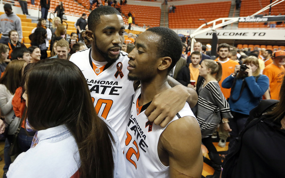 Photo - Oklahoma State Cowboys' Michael Cobbins (20) and Markel Brown (22) walks off the court after the 78-76 win over Iowa State during the college basketball game between the Oklahoma State University Cowboys (OSU) and the Iowa State University Cyclones (ISU) at Gallagher-Iba Arena on Wednesday, Jan. 30, 2013, in Stillwater, Okla.  Photo by Chris Landsberger, The Oklahoman