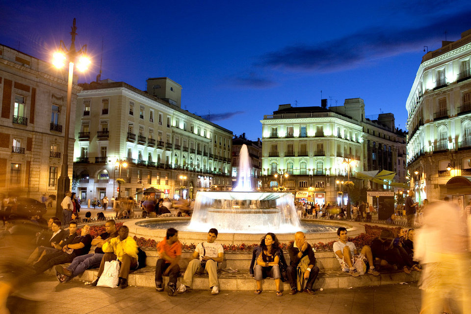 Photo - The Puerta del Sol is Madrid's version of Times Square; it's an engaging place to crowd-watch in the evening.   Photo by Dominic Bonuccelli    dominic arizona bonuccelli / azf