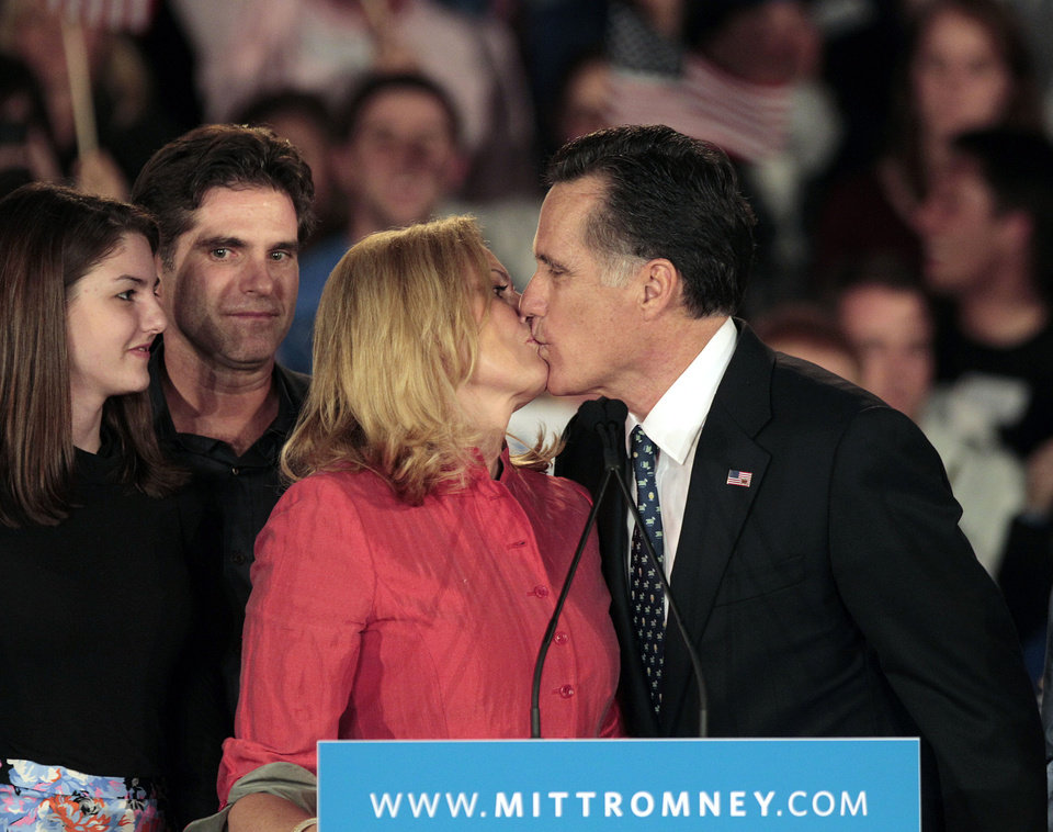 Photo - Republican presidential candidate, former Massachusetts Gov. Mitt Romney, right, kisses his wife Ann, as following his speech during the South Carolina Primary night rally as from left, granddaughter Allie and son Tagg look on Saturday, Jan. 21, 2012, in Columbia, S.C. (AP Photo/David Goldman) ORG XMIT: SCDG121